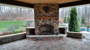outdoor fireplace paver patio: we tore out the deck then installed an elevated paver patio with a concrete base retaining wall sitting wall outdoor fireplace