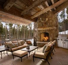 outdoor fireplace paver patio: exposed timbers patio rustic with patio furniture timber beams stone paver patio