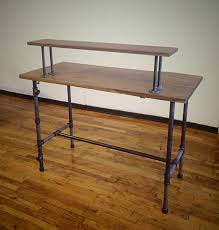 steel pipe legs standing desk with h stratcher and varnished wooden eased edge profile top on brown metal office desk