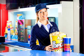 confident worker popcorn and drink at concession stand stock cover letter confident worker popcorn and drink at concession stand stock confident photoconcession stand worker