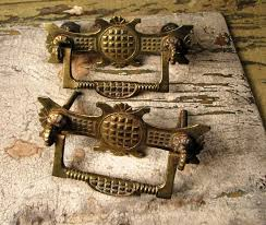 you should remove your brass hardware such as these drawer pulls before cleaning antique furniture cleaning