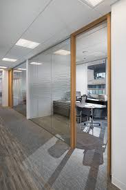 meeting room at fort capital office interior design by ssdg interiors inc wood meeting table black task chairs artwork glass sliding doors capital office interiors opening hours