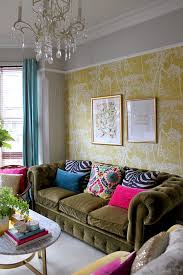 space living room olive: colourful eclectic living room with olive green velvet sofa