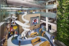 photo wwwemliicom known as torontos smartest building corus quay is all about fun and creativity bringing employees together in one space with slides amazing office space set