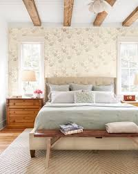 zones bedroom wallpaper: a sophisticated gray brown floral wallpaper mimics the hue of the weathered ceiling beams and