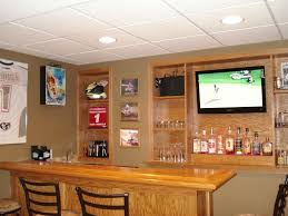 rustic style home basement bar after remodel design with furnish table plus wall built in furniture and wine storage and mounted tv in the middle rack ideas built home bar cabinets tv