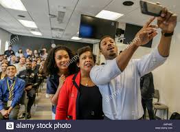 actor michael b right takes a selfie attorney actor michael b right takes a selfie attorney general loretta lynch and actress yara shahidi at a facebook live town hall meeting on the