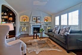 cowhide rugs living room traditional with armchair art niche ghost chair grey velvet sofa hide animal hide rugs home office traditional