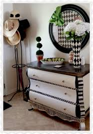 black and white photo collage make this wall a perfect place to show black painted furniture ideas