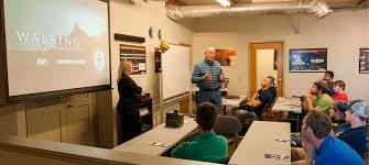 shipbuilding employment partner trade school ingalls trade manager david cobb presenting job opportunities to trade school