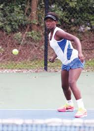 rain halts play in st round of a east regional tennis the hunt s taylor love the no 1 singles seed gets ready to return a