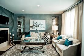 hgtv showhouse showdown tv show example of a mid sized trendy open concept living room design blue dark trendy living room