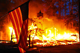 u s department of defense photo essay a u s flag hangs in front of a burning structure in the black forest fire in