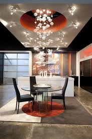 kitchen and dining area with bubble chandelier lighting and surrounding task lighting ambient lighting ideas