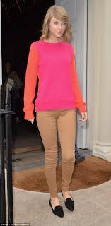 taylor swift goes bold in attention grabbing colour block jumper bold taylor swift stood out in a bright orange and pink sweater as she left