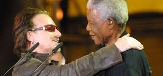 bono pens essay tribute to nelson mandela   channel nelson mandela and bono embrace at the           concert at green point stadium in cape town on  november    anna zieminski  afp