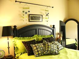 green black mesmerizing: bedroom cream bedroom wall theme with black wooden bed and green bedding bed combined by
