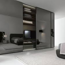 smoke glass sliding door wardrobe we love this added drama mirrored bedroom furniture