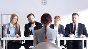 tips to impress your employer during your interview w during job interview and four elegant members of management shutterstock id 370947476 po