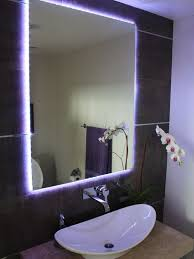 contemporary powder room with a stylish mirror lit with leds from behind bathroom mirror with lighting