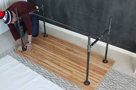 straightening the pipe legs of a diy work table black iron pipe table