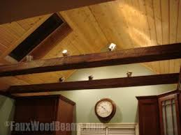 installing lights whether recessed or track lighting on a faux wood beam is deceptively beams lighting