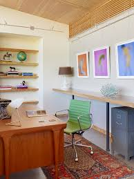 caterpillar house trendy home office photo with white walls and a freestanding desk century office