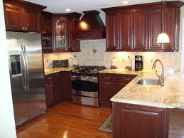kitchen cabinets with granite countertops: kitchen dark kitchens with wood and black cabis archaiccomely
