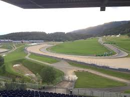 unlike other grandstands which offer panoramic views such as sud west or red bull its also a 30 40 minute walk from the main fan zone near turn 1 austria view red bull