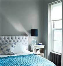 gray and blue bedroom design gray tufted headboard turquoise blue throw glass lamp with black shade and gray walls blue grey paint colors view