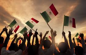 entrepreneurial spirit picks up steam in shareamerica crowd of people waving arms and mexican flags shutterstock