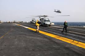 u s department of defense photo essay u s navy seahawk helicopters prepare to take off from the aircraft carrier uss ronald reagan in