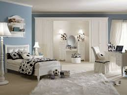fancy blue wall paint color background with black and white cow bedroom theme decor plus cream fancy black bedroom sets