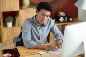 Online Hoemwork Resources   Channel One News Concentrated university student doing homework at home