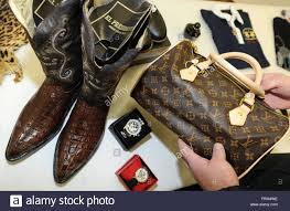 a customs official presents seized counterfeited branded goods at the main customs office in hanover germany 29 march 2012 due to increasing internet branded office merchandise