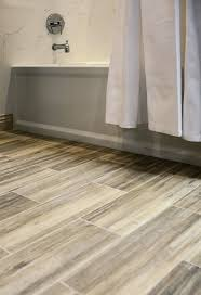 ceramic tile for bathroom floors: faux wood ceramic tile in the bathroom easy to clean and still gets the rich