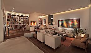 leather furniture ambient lighting living room wall shelving wood flooring ambient room lighting
