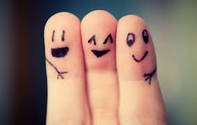 picture of three fingers with faces and arms drawn on them to make it look like three friends hugging