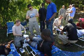 u s  department of defense  photo essay     combat medics and haitian medical volunteers treat patients at the forward operating base set up by