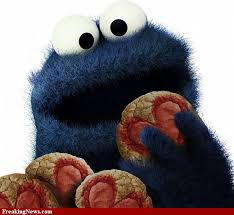 Cookie monster with hearts painted on his cookies