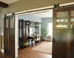 view in gallery industrial barn style doors conceal a spacious and traditional home office design barn style sliding doors