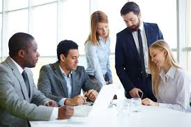 benefits of using a temp staffing agency to try before you buy group of business partners discussing ideas and planning work in