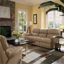 small living room wonderful brick wall large glass window white triangle feet floor lamp soft brown couch brick living room furniture