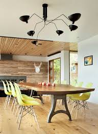 table lavish slab dining  serge mouille lighting and live edge dining table with metallic base