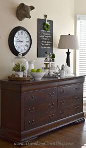 use a dresser in the kitchen or dining room to store kitchen and table linens charming pernk dining room