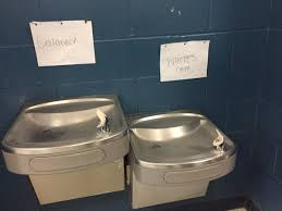 racially charged signs at jacksonville high school water racially charged signs at jacksonville high school water school leaders are investigating after two racist signs