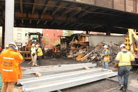 Metro North to Resume Regular Weekday Service on Friday  MTA Says     DNAinfo com Metro North workers wield temporary support beams to repair damages after a massive blaze occurred