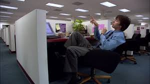 medium shot male office worker sitting at desk in cubicle and shooting rubber bands at ceiling los angeles stock footage video getty images band office cubicle