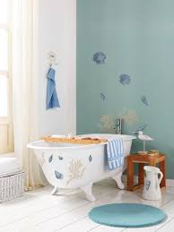 beach themed bathroom accessories idea: full size of  coastal cool seashells reef decal pattern on wall and tub blue round bath rug white ceramic bathroom floor tiled white curtain liner white bamboo wicker basket white seashells granite freestading bathtub curtain holdbacks