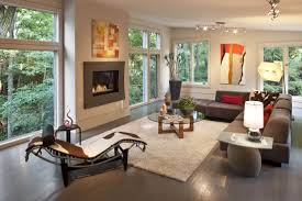 amazing white wood furniture sets modern design: sloped white ceiling over dark wood flooring in this living room holding modern armless brown sofa